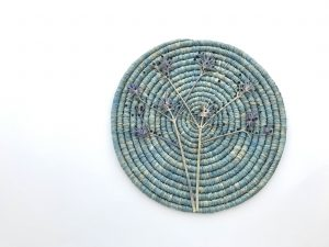 Sally Holliday, Roosting, Dyed raffia, pressed blue devil thistle, glass beads, nylon thread